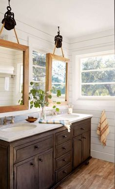 """With a whopping seven windows, the master bathroom presented a serious design challenge. """"I didn't w... - David Tsay"""