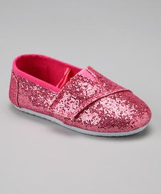 Sparkling feet are extra sweet! Featuring a secure hook and loop panel that extends across the top of the foot, these sturdy flats will make a shining statement with every skip.Hook and loop closureCanvas upperRubber soleImported