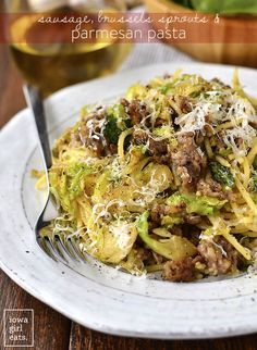 20 Minute Sausage, Brussels Sprouts and Parmesan Pasta will be on the table in no time. A filling and flavorful gluten-free dinner recipe!   iowagirleats.com