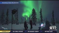 Magic moment of wedding proposal under aurora caught on camera with behind the scenes footage caught on videocamera.