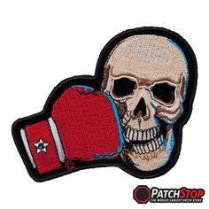 TKO Boxing Skull Motorcycle Patch - Embroidered tan skull as a red boxing glove is crushing the side of it's jaw, on a velvety black cut-out patch with a black border.