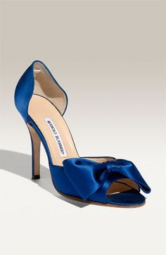 why are all the lovely blue shoes I want manolos. Damn that Carrie Bradshaw. Girl knew where it was at!