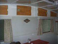 Pre-reno. Cupboards above bench.