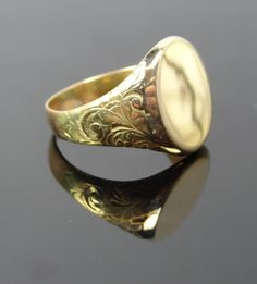 This is a hefty, thick and solid piece with gorgeous engraved details on the sides to add a touch of visual interest. Sized for a man's hand, this is a large piece of incredible craftsmanship dating to the early 1900's.