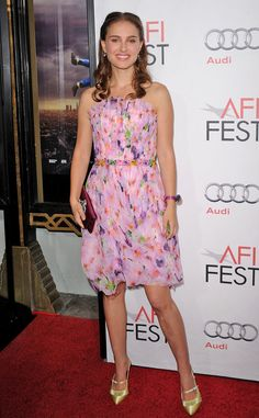 Portman in a pretty pink and floral Rodarte dress and gold sandals