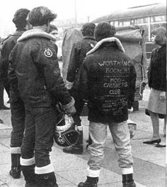 """mod crushers club ---"""" The Mods and Rockers were two conflicting British youth subcultures of the early-mid 1960s. Gangs of mods and rockers fighting in 1964 sparked a moral panic about British youths, and the two groups were seen as folk devils. The rockers adopted a macho biker gang image, wearing clothes such as black leather jackets. The mods adopted a pose of scooter-driving sophistication, wearing suits and other cleancut outfits."""""""