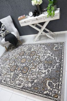 Runiullae Distressed Vintage Beige Light Grey Rug A marvelous exhibit of trendsetting rugs, this Collection instills life into extraordinary spaces. Expertly power-loomed in Turkey, these rugs are easy-care and virtually non-shedding. Classic designs become fashion-smart home decor in this alluring and playful collection.