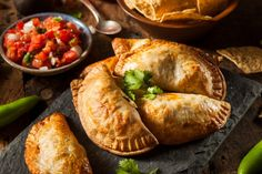 Buy Homemade Stuffed Chicken Empanadas by on PhotoDune. Homemade Stuffed Chicken Empanadas on a Background Pie Recipes, Mexican Food Recipes, Cooking Recipes, Chicken Empanadas, Savory Pastry, Cheesy Chicken, Food Photo, Food To Make, Good Food