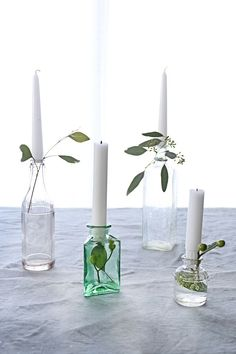 This simple spring candleholder combines all sorts of fun elements like fresh greenery and vintage glass.  They will be sure to add a whimsical touch to your tabletops this spring!
