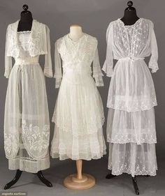 THREE WHITE COTTON TEA GOWNS, c. 1915 1 lawn w/ triple tier embroidered skirt & blouson top; 2 net: 1 w/ bodice & over-skirt in heavily embroidered roses & 1 trimmed in chemical & filet lace, 3 hem flounces Edwardian Clothing, Edwardian Dress, Antique Clothing, Edwardian Fashion, Vintage Fashion, Edwardian Era, Vintage Beauty, Vintage Gowns, Vintage Outfits