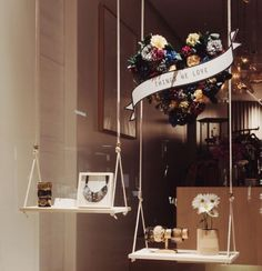 """""""Mother's Day display idea with retail #storewindow swings. Stay display inspired! #visualmerchandising #giftshop #vm #giftshoppe #display #retail…"""""""