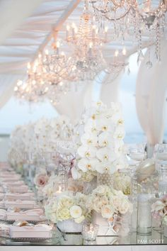 I love the crystal chandeliers, soft white fabric and clean, modern white palette.  Lots of phalaenopsis orchids, too!  Gorgeous!
