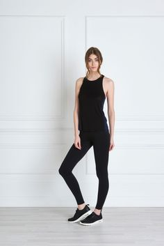 Maria Black Tank -  A faultless fit and soft, non-toxic jersey material make the Maria Tank a must have. The scooped racer back and high neckline front are impeccably assembled with bonded seams. A multipurpose piece, it can be worn from the markets to the Yoga mat, with many a tea date in-between.