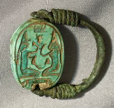 *SCARAB FINGER RING:  New Kingdom, Ramesside, Dynasty 19-20, Reing of Amenhotep II, c. 1295-1070 B.C. Geography: Upper Egypt, Thebes, Bronze or copper alloy, glazed steatite-Formerly in the collection of the Reverend Chauncey Murch   (died 1907). Collected between 1883+1906 while Murch was a missionary in Egypt. Collection purchased by the Museum from the Murch family with funds provided by Helen Miller Gould, 1910.