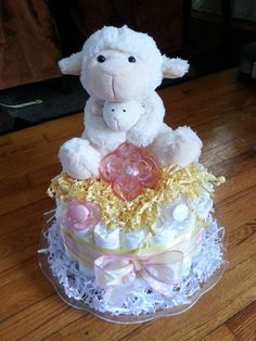little lamb diaper cake    http://www.etsy.com/shop/YouMeAndBabyToo    What better gift to give Mommy to be than diapers! Diaper cakes make wonderful gifts, center pieces or just a cute decorative piece to your special occasion.     All diaper cakes are custom made to order. You choose the number of tiers, from 1-4. Let me know what your colors and/or theme will be, and I will create something special just for you!    1 tier $20.00