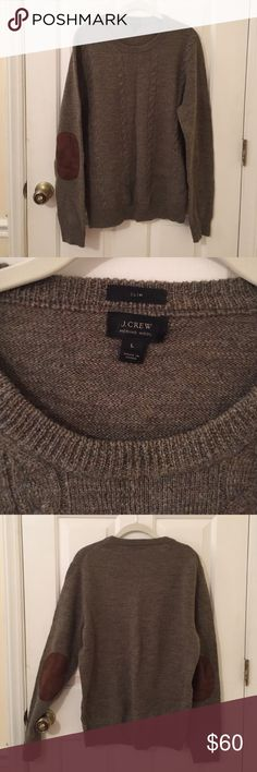 J. Crew merino wool pullover Forest green j crew sweater with cable knit effect And brown elbow patches. I bought this for my boyfriend and it was a little too small for him, but I wore it once as an oversized sweater! Very comfortable. Perfect condition. J. Crew Sweaters Crewneck