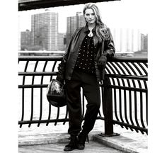 Marina Rinaldi - Collection for Curvy women  Long-line black nappa leather jacket worn over micro-studded stretch viscose jersey T-shirt, techno-jersey cuffed trousers and velvet and calfskin ankle sneakers.
