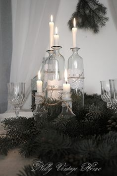 Clear bottles with white candles, World Market- bottles or use your own, eyelet or lace, package twine, candles. Voila....