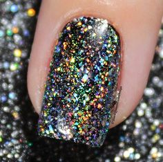 Mesmerized by the close up Chrome HOLO flakies! Manicure by blackqueennailsdesign is using our Mitty Shattered Rainbow Nail Art Powder found at snailvinyls.com
