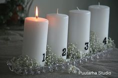 A light and graceful Advent wreath on a crystal tray with baby's breath.