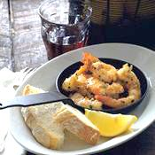 Garlic Shrimp -  Ingredients:  1/4 cup olive oil  4 large cloves garlic, finely minced  1 teaspoon red pepper flakes  1 pound medium shrimp, peeled and deveined    Save Now  2 tablespoons fresh lemon juice  2 tablespoons dry sherry  1 teaspoon paprika  Chopped fresh flat-leaf (Italian) parsley for garnish