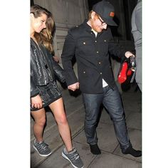 Ed Sheeran goes barefoot to give his girlfriend Cherry Seaborn his trainers after she breaks a heal