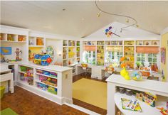 Love these built-in cabinets to separate play room areas