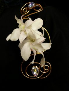 Gold and white corsage for wedding and prom