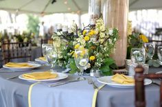 grey table cloth and grey with yellow piping runner.  they grey on grey with pops of yellow is perfection in this must-see yellow and grey modernly classic wedding at home | photos by miles witt boyer