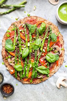 Cauliflower pizza crust recipe. Really easy to make, great, healthier alternative to traditional pizza, topped with asparagus and spinach dressing.