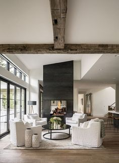 Grand living room with wood beams. #livingroominspo #woodbeams