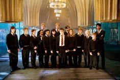 HARRY POTTER AND THE ORDER OF THE PHOENIX, Daniel Radcliffe (center, front), Bonnie Wright (third from left), Katie Leung (seventh from left), Emma Watson (fifth from right), Rupert Grint (fourth from right), Evanna Lynch (third from right), Alfred Enoch (