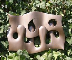 Work by Boris Kopilevich.  http://boriska2009.wix.com/wood-and-metal