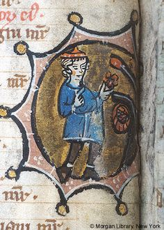 Psalter, MS M.113 fol. 3v - Month, Occupation: May -- Man wearing hat picks flower from bush. Basket of flowers hangs from branch of bush.