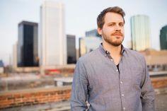 Portrait of man on urban rooftop
