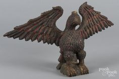 Carved and painted eagle, in the manner of Wilhelm Schimmel, 12 3/4'' h., 24'' w. - Price Estimate: $400 - $800