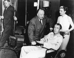 Alfred Hitchcock, James Stewart and Grace Kelly during the filming of Rear Window [via eBay]