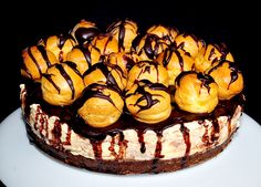 Chocolate Fudge Profiterole  Price:  £25.84  A real show stopper! Chocolate biscuit base with a rich chocolate fudge cream cheese filling. Topped with more chocolate fudge then cream-filled profiteroles and finally more chocolate fudge. Serves 12