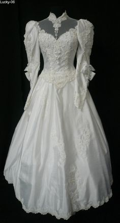 wedding dress hopefully. something with coverage so I don't have to add anything to her arms