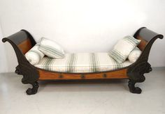 A beautiful 19th century mahogany and black laquered wood  daybed .Period First Empire, Napoléon .