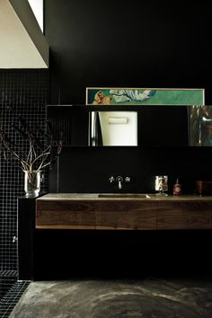 Private Home, black bathroom. Natural, contemporary African feel.