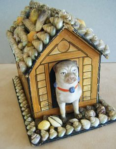 C1890. Victorian shell art money box made of cardboard and then covered with shells. The dog is ceramic.