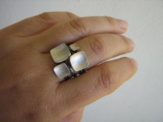 These stack rings are so simple yet very elegant as a cluster.. The square shape of these stacking rings is a bit soft-square for an organic taste and easy use. I hammered them into a bowl shape. I must admit I can not stop myself playing with the possibilities of the combination every time I wear mine.. It is fun! You can just wear one of them or stack them as 2, 3, 4 altogether (please check out the listing for the singles and other alterations). You can also combine these with your other…