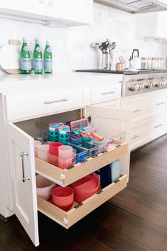 How to organize kids tupperware, water bottles, and plates in the kitchen. How to organize the kids drawer. Tips for organizing the kids kitchen cabinet. Our Home : The Kids Cabinet – Mika Perry Kitchen Cabinet Organization, Kitchen Drawers, Organization Hacks, Kitchen Cabinets, Cabinet Ideas, Kids Bathroom Organization, Pantry Storage, Storage Cabinets, Kitchen Storage