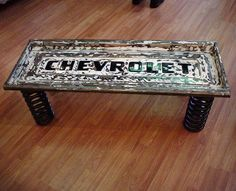 Coffee table from repurposed Chevy Chevrolet metal tail gate and spring legs, recycled art; Upcycle, Recycle, Salvage, diy, thrift, flea, repurpose!  For vintage ideas and goods shop at Estate ReSale & ReDesign, Bonita Springs, FL