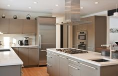 modern European kitchen: a balanced composition of masses, cabinet hardware unifies the room