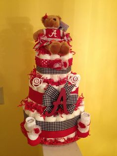 Alabama Diaper Cake that I made for a child bathe...Roll Tide!!.... See even more by clicking the image