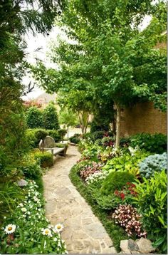 Beautiful side garden idea.  Site has lots of pictures of backyards and side yard ideas.