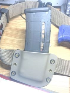 Flat dark earth kydex pmag pouch with coyote rivets and screws.