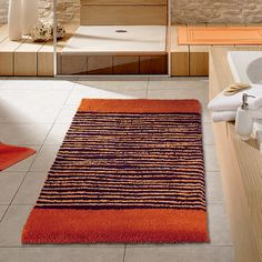 Orange is a very popular color theme for a bathroom. It is exciting and fresh and just beautiful! From bathroom rugs to towels we have something that will work for you in your bathroom!Please contact us a www.vitafutura.com with questions about any of the items in this picture.
